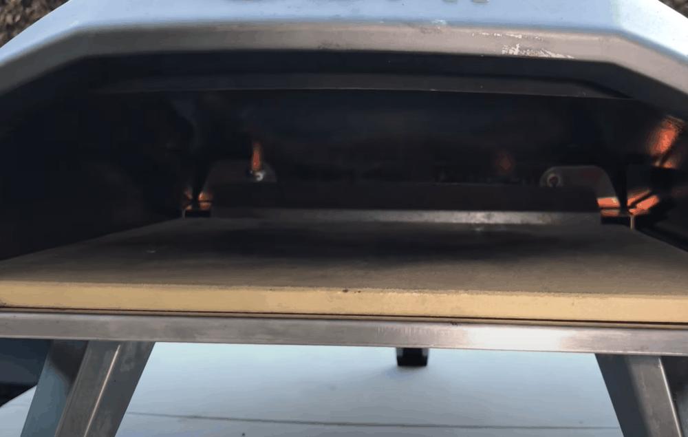 pre-heat the pizza stone in the oven