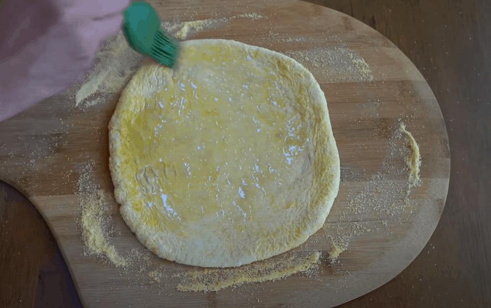 Oil the dough